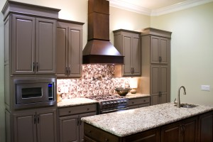 Decatur, GA New modern luxury kitchen cabinets, with gas stove and granite countertops and high ceiling.
